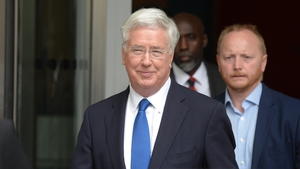 The British Defence Secretary apologised for touching a journalist's knee