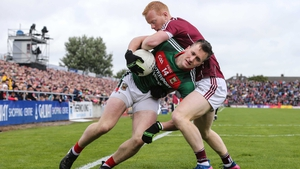 Declan Kyne of Galway and Mayo's Cillian O'Connor tussle