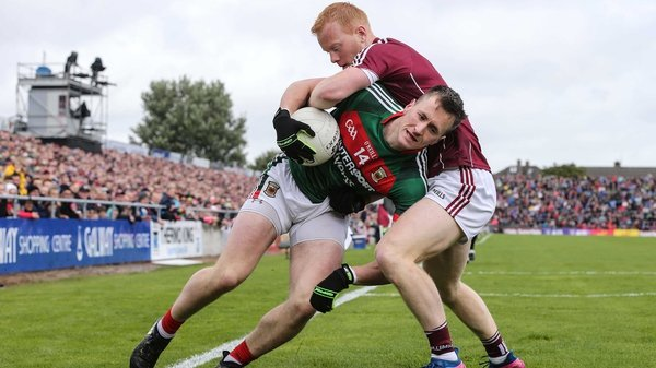 Galway's Declan Kyne tackles Cillian O'Connor of Mayo tangle in Salthill