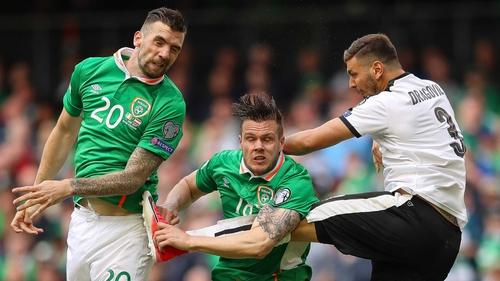 Shane Duffy (L) and Kevin Long rise to head clear