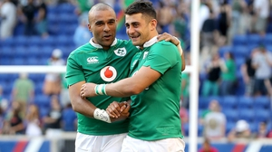 Tiernan O'Halloran (R) celebrates with Simon Zebo after Ireland beat the USA