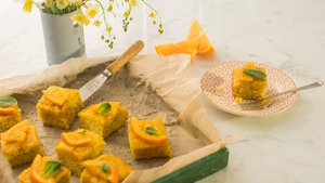 The inclusion of polenta in this fragrant and moist tray bake makes it incredibly light in texture. The fresh, zesty flavours of the oranges teamed with the sweet, sticky drizzle is a match made in heaven.