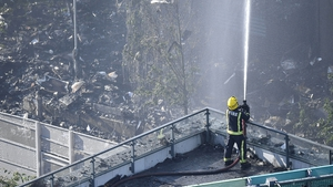A fire fighter tackles the blaze at the scene