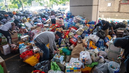 Volunteers sort through donations