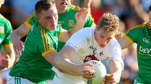 Daniel Flynn of Kildare evades a swarm of Meath bodies