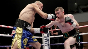 Paddy Barnes (r) in action against Silvio Olteanu