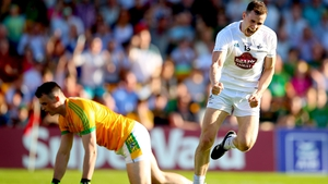 Meath's goalkeeper Paddy O'Rourke dejected as Cathal McNally celebrates scoring his side's opening goal