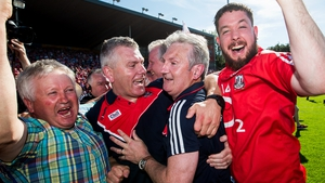 Cork boss Kingston celebrates with assistant Diarmuid O'Sullivan and the Rebel faithful
