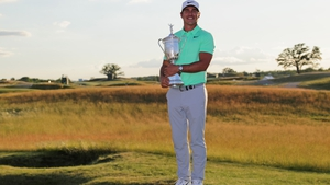 Brooks Koepka with the USA Open trophy