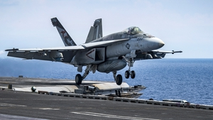 A US F/A-18E Super Hornet aircraft taking off from the aircraft carrier USS Carl Vinson in the South China Sea