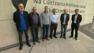 Six men are accused of falsely imprisoning Joan Burton and her adviser Karen O'Connell