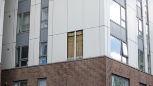 A hole where a panel of cladding was removed is pictured on the Bray residential block in the Chalcots Estate in Swiss Cottage, London