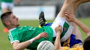 Danny Neville of Limerick takes a tumble against Clare