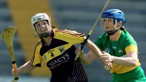 Karen Atkinson and Rachel Brennan battle for possession