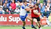 Connaire Harrison fends off the challenge of Monaghan defender Drew Wylie