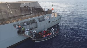 Rescued migrants being brought aboard the Irish Navy vessel