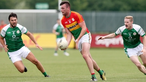 Carlow's Eoin Ruth escapes the attentions of two London players