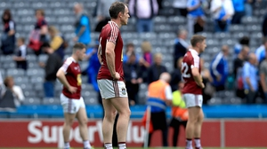 Westmeath players stand dejected at the final whistle