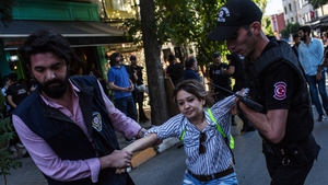 A woman is arrested by police after gathering to support the Pride march in Istanbul