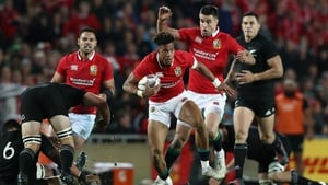 Anthony Watson of the Lions breaks with the ball