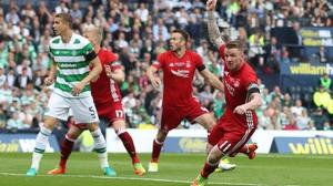 Jonny Hayes (R) in action for Aberdeen against Celtic last season