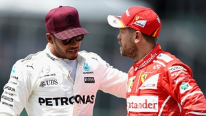 Hamilton (L) and Vettel are at odds over what happened in Azerbaijan