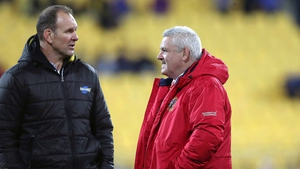Lions' head coach Warren Gatland speaks with Hurricanes' assistant coach John Plumtree before the game