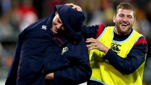 Lions' Finn Russell jokes with Robbie Henshaw at half-time