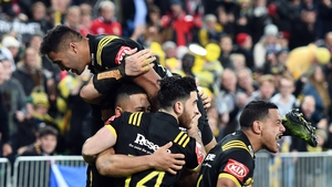 The Hurricanes celebrate one of their four tries