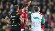Iain Henderson is yellow carded by Romain Poite