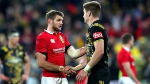 Dan Biggar and Jordie Barrett shake hands after the game
