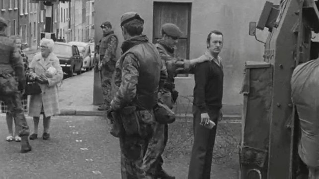 People being searched at British Army checkpoint in Derry (1972)