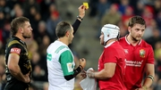 Referee Romain Poite shows Henderson a yellow card