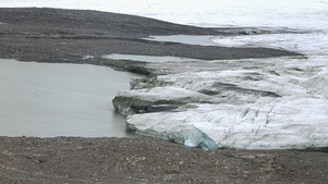 Recently uncovered earth is seen near one of Greenland's retreating glaciers