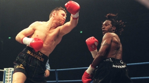 Steve Collins (L) swings and misses Nigel Benn in their November 1996 rematch in Manchester