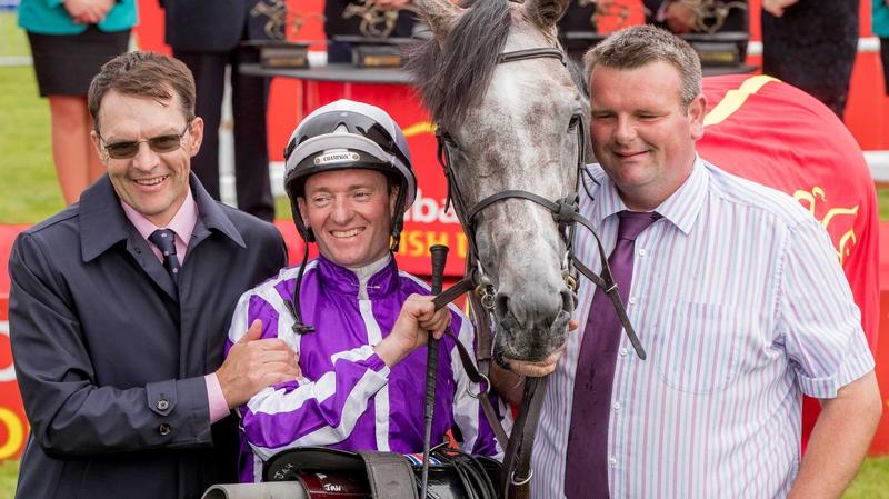 Trainer Aidan O'Brien, jockey Seamie Heffernan and David Hickey celebrate winning The Dubai Duty Free Irish Derby with Capri