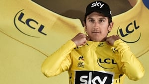 Geraint Thomas pulls on the first yellow jersey of the 2017 Tour