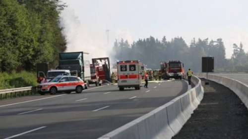 Coach on fire after motorway crash - 31 people injured & 17 feared dead
