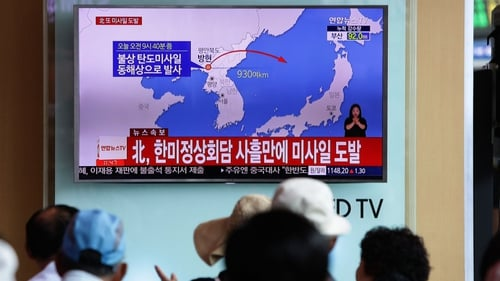People watch a television broadcast reporting the North Korean missile launch at the Seoul Railway Station in South Korea