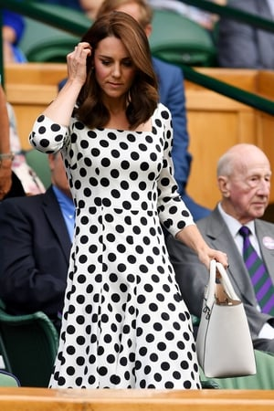 The Duchess of Cambridge looks on from centre court wearing a Dolce and Gabbana polka dot dress.