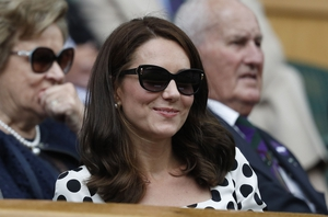 Kate wore a pair of Bulgari cat-eye sunglasses to complement her new haircut.