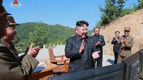 Kim Jong-un celebrates what North Korea claimed was a successful ICBM launch