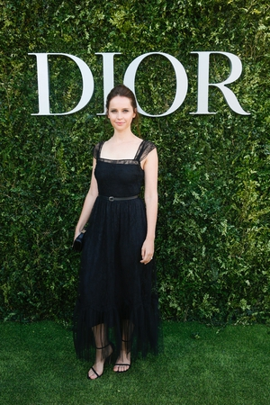 Oscar winning actress Felicity Jones looks beautiful in black at the designer event.