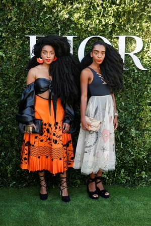 US twin sisters TK Wonder and Cipriana Quann slay with beautiful outfits and iconic hair.