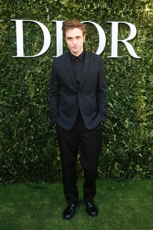 Actor Robert Pattinson looks chic in all black at the Dior photocall.