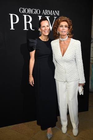 July 4: Icon Sofia Loren shone in white alongside Giorgio Armani's niece, Roberta, at the Armani Fashion Show.