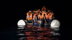 Migrants on a rubber vessel off the Libyan coast