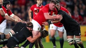 Tadhg Furlong is tackled by Sam Whitelock and Joe Moody