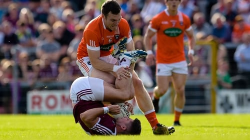 WestmeathÕs John Egan is fouled by Brendan Donaghy of Armagh