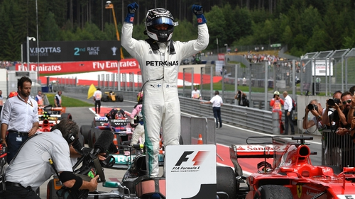 A jubilant Bottas on his return to the pits